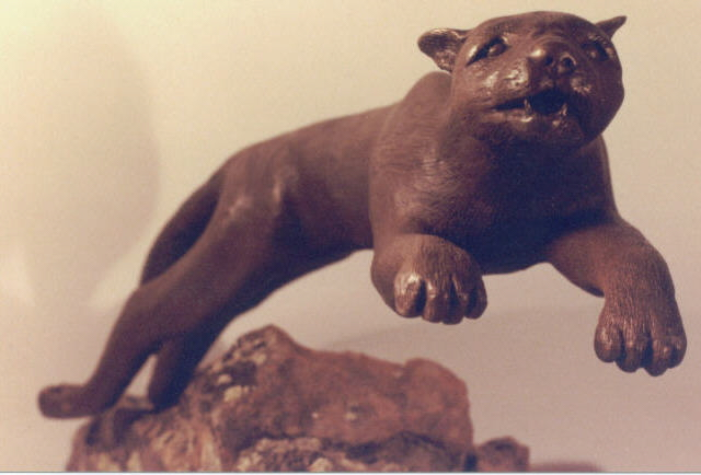 Cougar is bronze mounted on moss rock